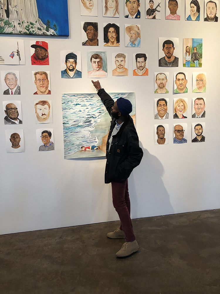 "Rudy in front of as series of his work in ""Everything in the Universe is My Brother"" at Smack Mellon. Photo Credit: Kemi Ilesanmi"