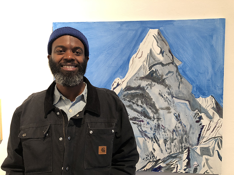 Rudy in front of Mount Everest from the Holy Mountain Series (2016). Photo Credit: Kemi Ilesanmi