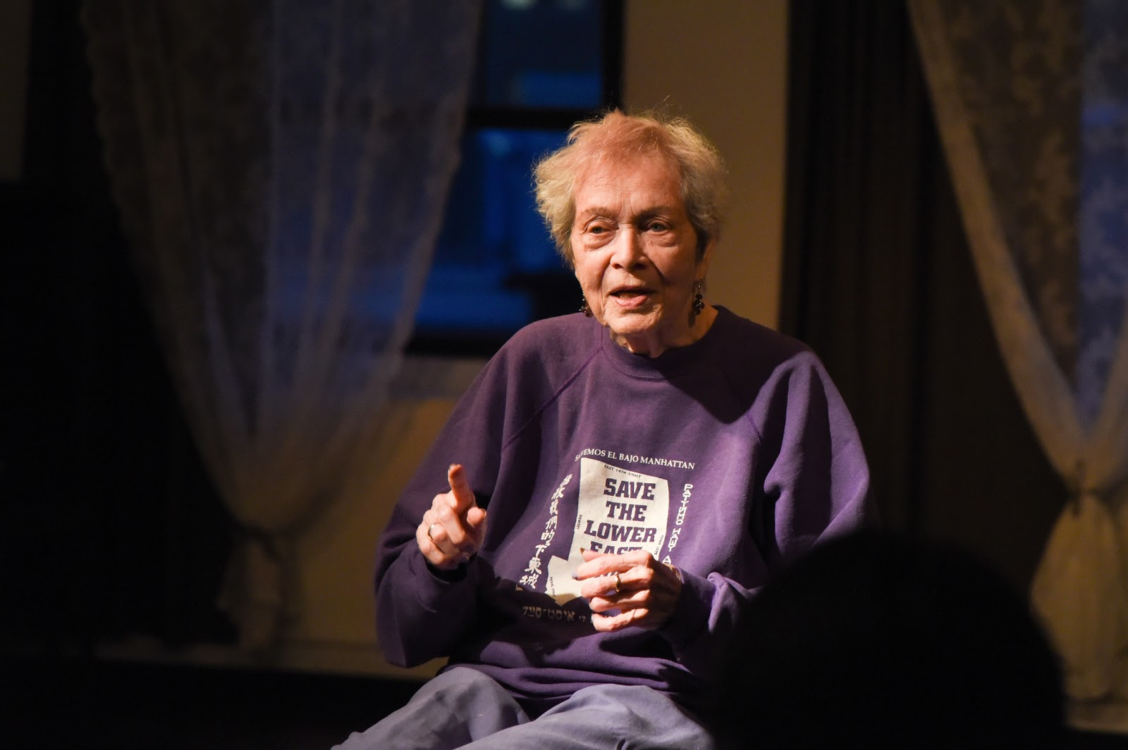 (A photo of Fran Goldin (91 years old) telling a story at a past Five Boro Story Project event)